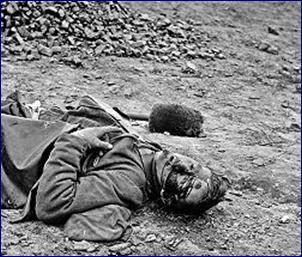 A dead soldier in Petersburg, Virginia 1865, photographed by Thomas C. Roche.